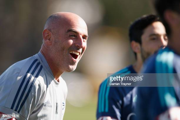 Coach of the Melbourne Victory Kevin Muscat has a laugh during a Melbourne Victory training session at AAMI Park on August 22 2017 in Melbourne...