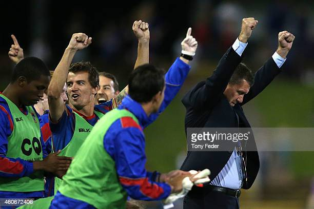Coach of the Newcastle Jets Phil Stubbins celebrates after beating Adelaide during the round 12 A-League match between the Newcastle Jets and...