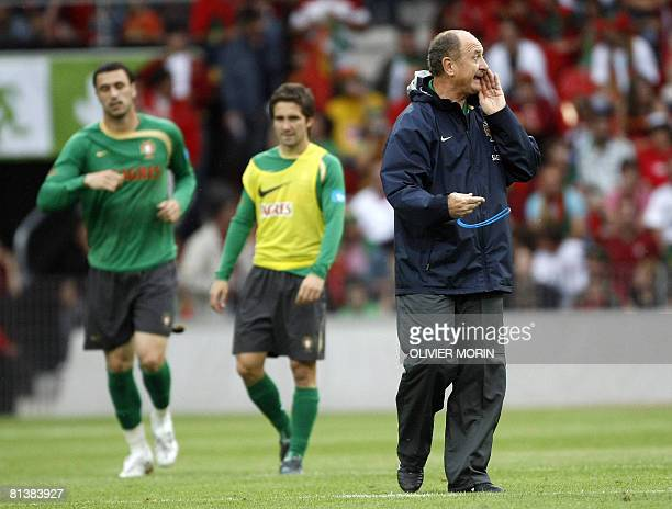 Coach of the Portuguese national football team Luiz Felipe Scolari gives instructions to his players during a training session at Neuchatel on June...