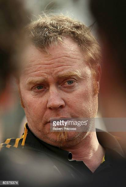Coach of the Tigers Simon Atkins talks to his players during the round 18 VFL match between the Werribee Tigers and the Box Hill Hawks at Bartercard...