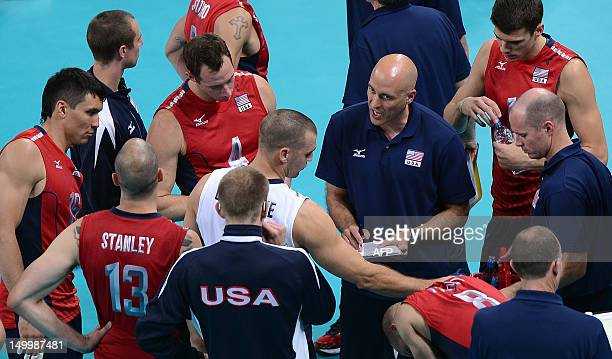 Coach of the US Alan Knipe talks with his players during the men's quarter-final volleyball match of the London 2012 Olympic Games at the Earl's...