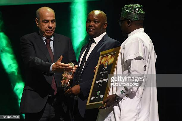 Coach of the Year Mamelodi Sundowns Pitso Mosimane receives her award during the African Footballer of the Year Awards in Abuja on January 5 2017...