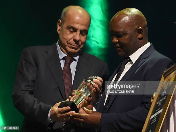 Coach of the Year Mamelodi Sundowns Pitso Mosimane receives his award during the African Footballer of the Year Awards in Abuja on January 5 2017...