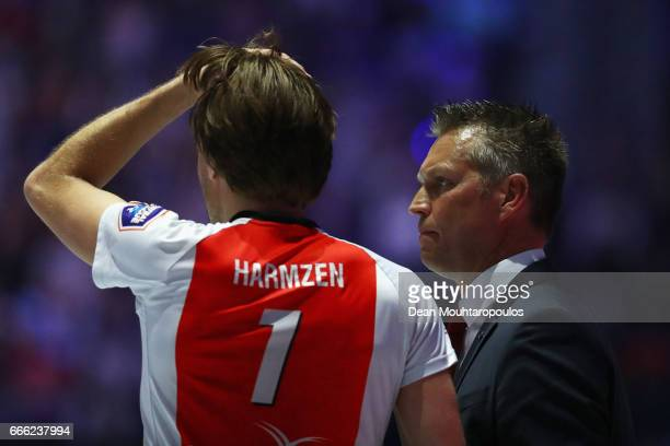 Coach of Top Quoration Jan Niebeek gives his player Daniel Harmzen instructions during the Dutch Korfball League Final between BlauwWit and...