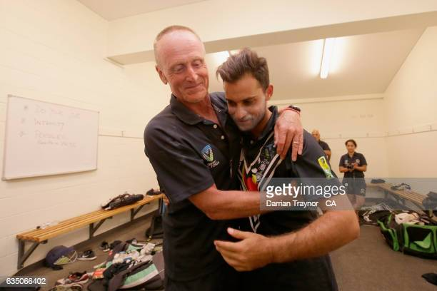 Coach of Victoria Julien Weiner and captain Ben Abbatangelo embrace after Victoria won the National Indigenous Cricket Championships Final against...