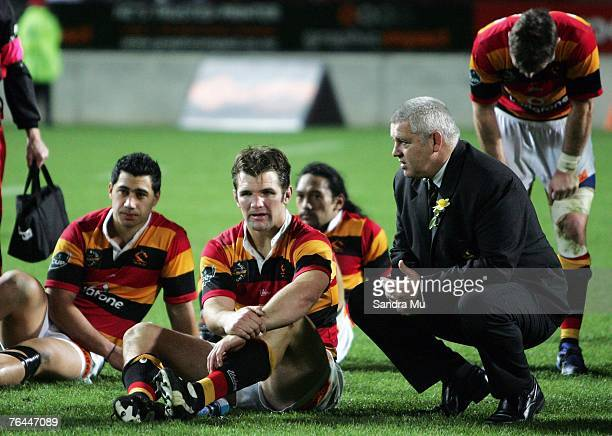Coach of Waikato Warren Gatland talks with Steven Bates after their loss to Canterbury in the Air New Zealand Cup match between Waikato and...