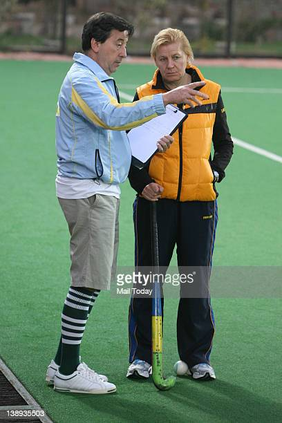 Coach of Women Hockey team of Ukraine Svitlana Makaieva with the team advisor Jose Brasa during a practice session ahead of the Olympic qualifier at...
