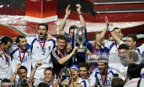 Coach Otto Rehhagel of Greece celebrates with the trophy after winning the UEFA Euro 2004 Final match between Portugal and Greece at the Luz Stadium...