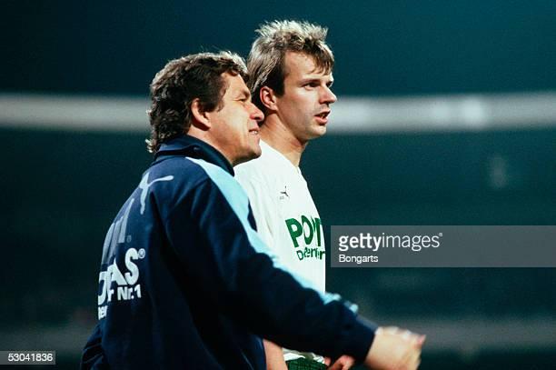 Coach Otto Rehhagel of Werder Bremen gives instructions to Manfred Bockenfeld of Werder Bremen during the 1bundesliga game between Werder Bremen and...