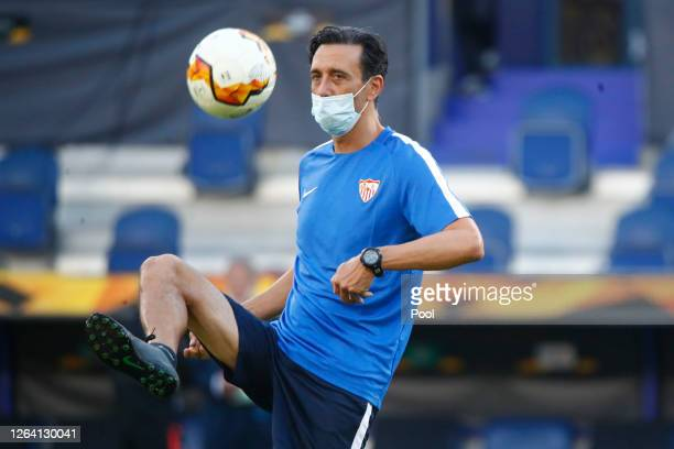 Coach Pablo Sanz wears a mask during a Sevilla Training Session And Press Conference at MSV Arena on August 05 2020 in Duisburg Germany