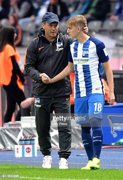 coach Pal Dardai and Sinan Kurt of Hertha BSC during the Bundesliga match between Hertha BSC and Hamburger SV on October 1 2016 in Berlin Germany
