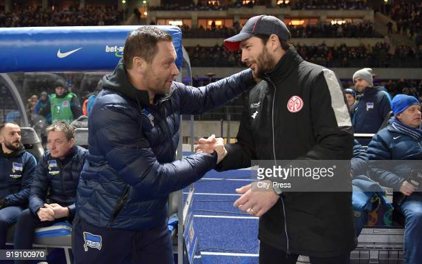 coach Pal Dardai of Hertha BSC and coach Sandro Schwarz of FSV Mainz 05 before the first Bundesliga game between Hertha BSC and 1st FSV Mainz 05 at...