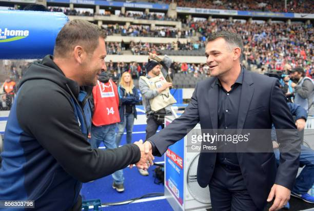 coach Pal Dardai of Hertha BSC and coach Willy Sagnol of FC Bayern Muenchen before the game between Hertha BSC and FC Bayern Muenchen on october 1...