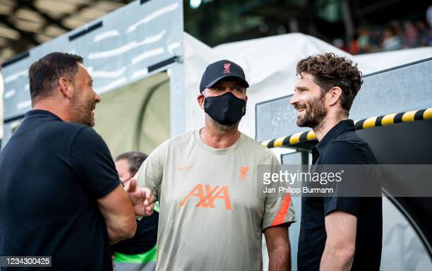 Coach Pal Dardai of Hertha BSC, coach Juergen Klopp of FC Liverpool and sports director Arne Friedrich of Hertha BSC before the friendly match...