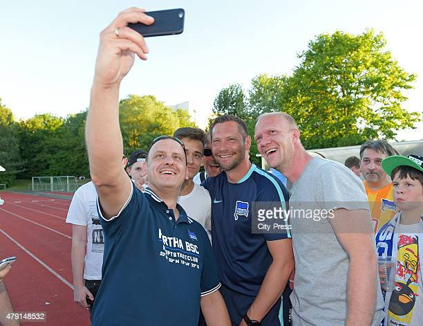 coach Pal Dardai of Hertha BSC with fans during the game between dem 1 FC Luebars and Hertha BSC on July 1 2015 in Berlin Germany