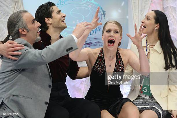 Coach Pasquale Camerlengo skaters Andrew Poje and Kaitlyn Weaver of Canada and coach Anjelika Krylova react after coming second in the Ice Dance Free...