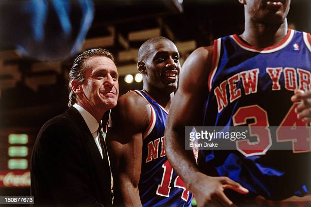 Coach Pat Riley with Anthony Mason and Charles Oakley of the New York Knicks during a game played in 1992 at the Veterans Memorial Coliseum in...