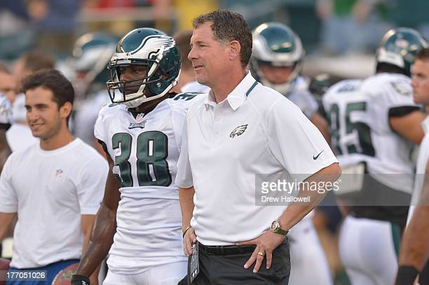 Coach Pat Shurmur of the Philadelphia Eagles talks with Felix Jones during warm ups before the game against the New England Patriots at Lincoln...