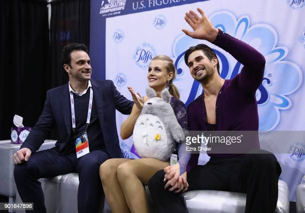 Coach Patrice Lauzon sits with Madison Hubbell and Zachary Donohue in the kiss in cry after they received their score following the Championship...