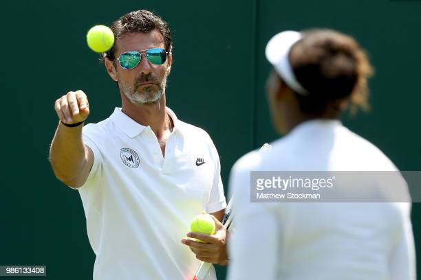 Coach Patrick Mouratoglou watches as Serena Williams of the United States practices on court during training for the Wimbledon Lawn Tennis...