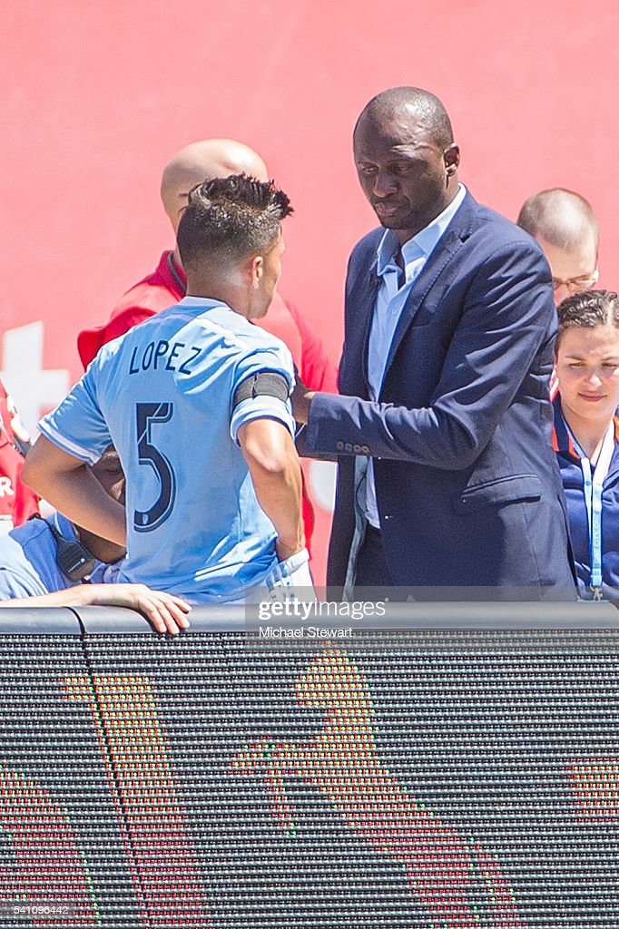 Coach Patrick Vieira gives instructions to midfielder Mikey Lopez #5 of New York City FC before he enters the match vs Philadelphia Union at Yankee Stadium on June 18, 2016 in New York City. New York City FC defeats Philadelphia Union 3-2.