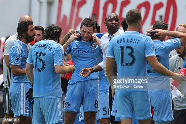 Coach Patrick Vieira talking to his players including Frank Lampard and Andrea Pirlo of New York City FC during a drinks break in searing heat during...