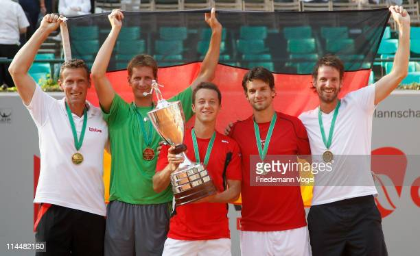 Coach Patrik Kuehnen Florian Mayer Philipp Kohlschreiber Philipp Petzschner and Christopher Kas celebrate after winning the Power Horse World Team...