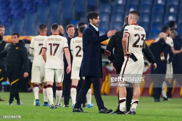 Coach Paulo Fonseca of AS Roma and Gianluca Mancini of AS Roma during the UEFA Europa League Quarter Final: Leg Two match between AS Roma and Ajax at...