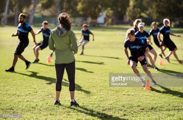 coach paying attention on team training - sports league stock pictures, royalty-free photos & images