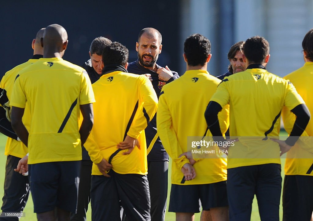 Coach Pep Guardiola of Barcelona addresses his players during the Barcelona training at Marinos Town on December 12, 2011 in Yokohama, Japan.