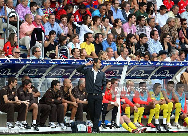 Coach Pep Guardiola of Barcelona follows his players during the La Liga match between Numancia and Barcelona at the Los Pajaritos Stadium on August...