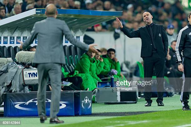Coach Pep Guardiola of Manchester City and coach Andre Schubert of Gladbach gestures during the UEFA Champions League match between VfL Borussia...