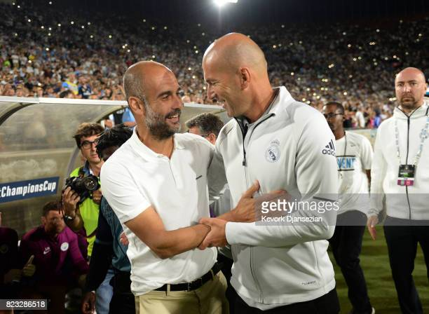 Coach Pep Guardiola of Manchester City and coach Zinedine Zidane of Real Madrid hug before the stat of the International Champions Cup 2017 soccer...
