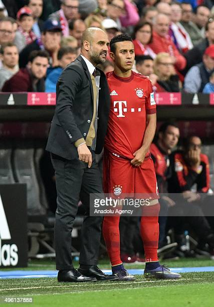 Coach Pep Guardiola of Munich gives instructions to Thiago during the Bundesliga soccer match between Bayern Munich and VfB Stuttgart at the Allianz...