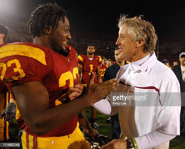 USC coach Pete Carroll congratulates Chauncey Washington after 3510 victory over Oregon in Pacific10 Conference football game at the Los Angeles...