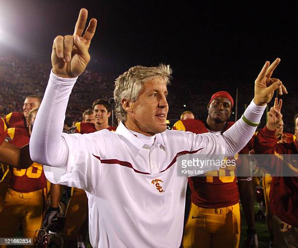 """Coach Pete Carroll holds up the """"Fight On"""" sign in celebration after 28-21 victory over Arizona State in Pacific-10 Conference game for the Trojans'..."""