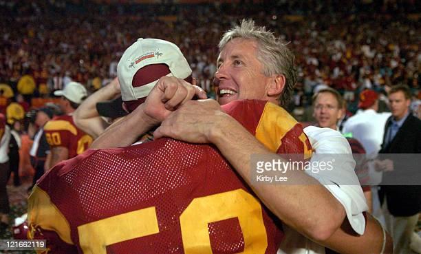 USC coach Pete Carroll hugs Lofa Tatupu after 5519 victory over Oklahoma in the FedEx Orange Bowl in Miami Fla on Tuesday Jan 4 2005