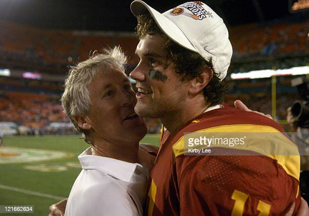 Coach Pete Carroll hugs quarterback Matt Leinart in the final minute of 55-19 victory over Oklahoma in the FedEx Orange Bowl at Pro Player Stadium in...
