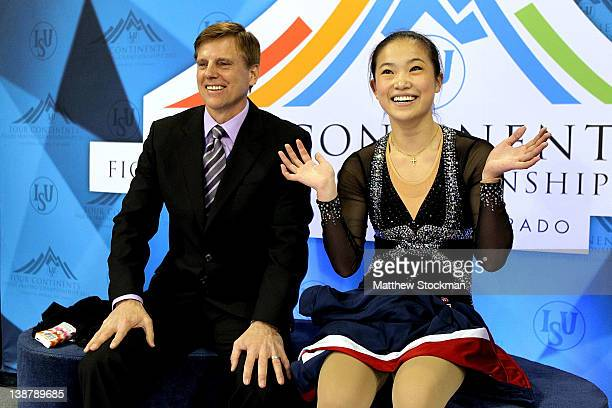 Coach Peter Oppegard and Caroline Zhang wait for her scores in the Kiss Cry after the Ladies Free Skate during the ISU Four Continents Figure Skating...