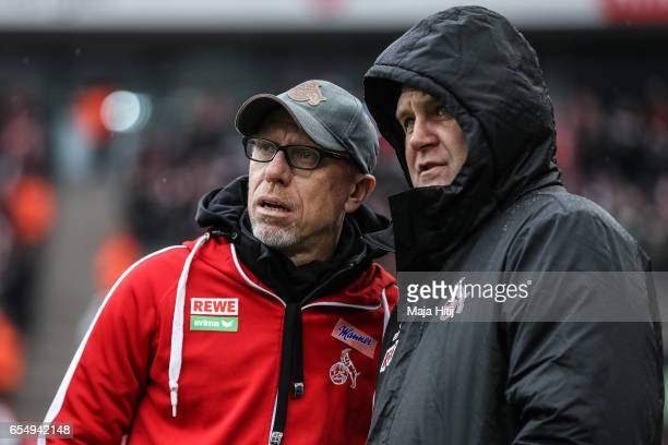 Coach Peter Stoeger of Koeln and sport Director Joerg Schmadtke look on prior the Bundesliga match between 1 FC Koeln and Hertha BSC at...