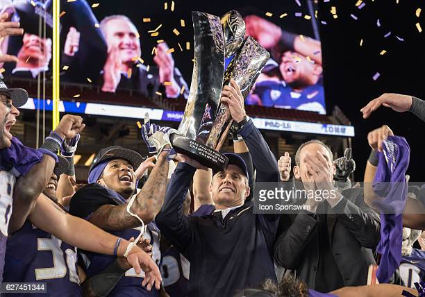Coach Peterson takes home the PAC12 trophy in the Pac12 Championship game between the Washington Huskies verses the Colorado Buffaloes on December 2...