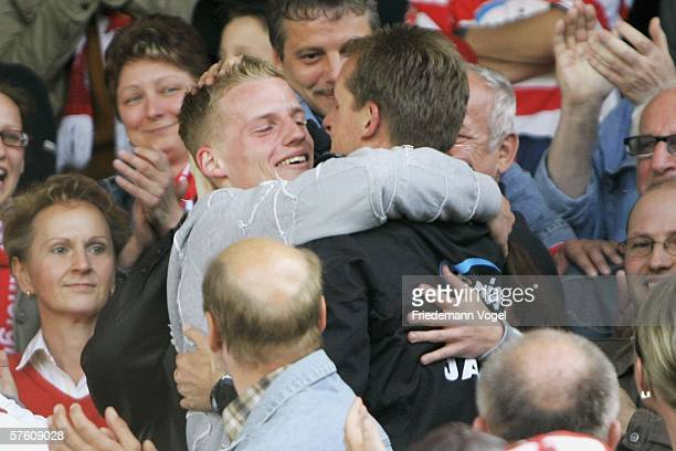 Coach Petrik Sander of Cottbus celebrates with his son Fabian Sander after the winning Second Bundesliga match between Energie Cottbus and 1860...