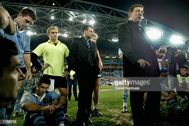 Coach Phil Gould of the Blues consoles hi players after the draw as captain Andrew Johns sits dejected during game 3 of the NRL State of Origin...