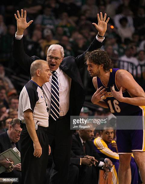 Coach Phil Jackson and Pau Gasol both of the Los Angeles Lakers have word with an official during a game against the Boston Celtics at the TD Garden...