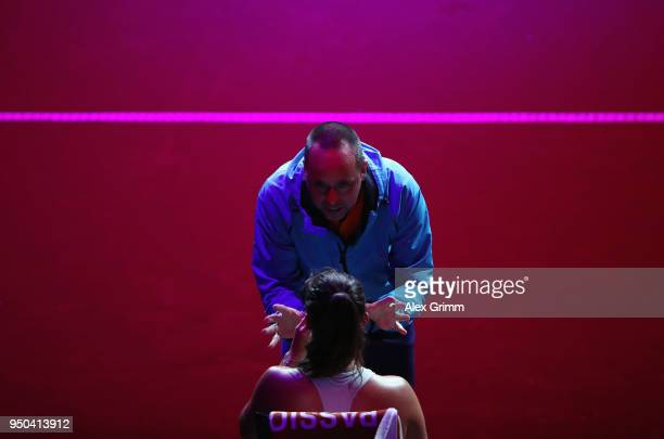 Coach Philippe Dehaes talks to Daria Kasatkina of Russia during her match against Magdalena Rybarikova of Czech Republic during day 1 of the Porsche...