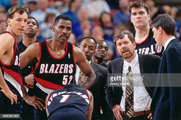 Coach PJ Carlesimo of the Portland Trail Blazers meets with his team during the game against the Sacramento Kings circa 1996 at Arco Arena in...