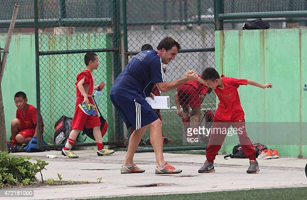A coach play with a student after training at Evergrande Football School on April 29 2015 in Qingyuan Guangdong Province of China Evergrande Football...