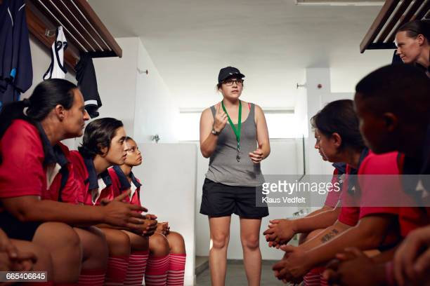 coach prepping rugby team before game - sportkleding stock pictures, royalty-free photos & images