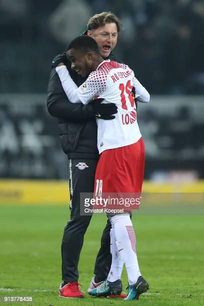 Coach Ralph Hasenhuettl of Leipzig embraces Ademola Lookman of Leipzig after the Bundesliga match between Borussia Moenchengladbach and RB Leipzig at...