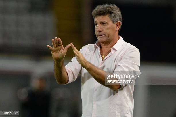 Coach Renato Gaucho of Brazil's Gremio gives instructions to his players during their Copa Libertadores football match against Venezuela's Zamora at...